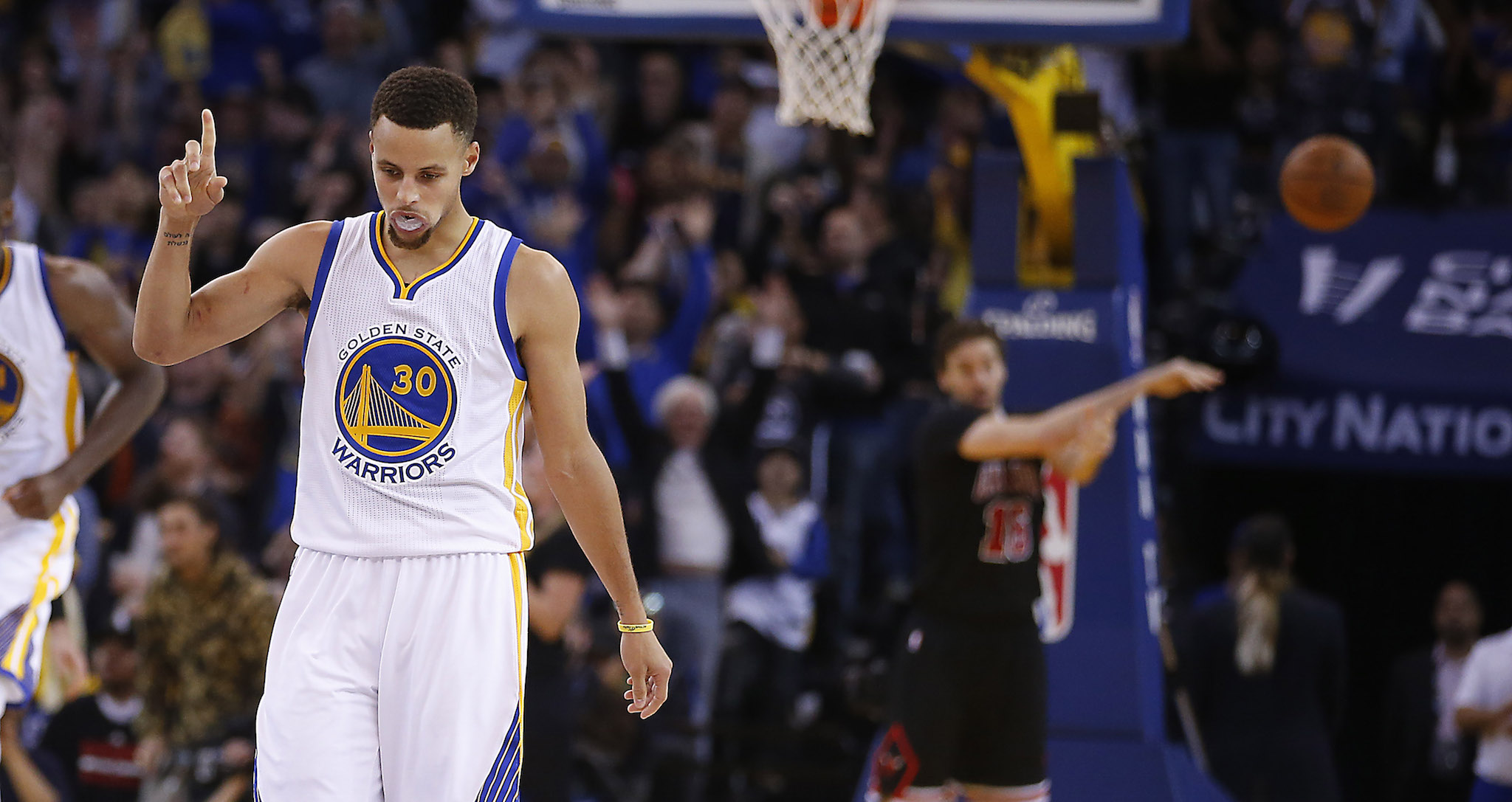 2709d3595757 Golden State Warriors  Stephen Curry reacts after making a 3-point shot  against the