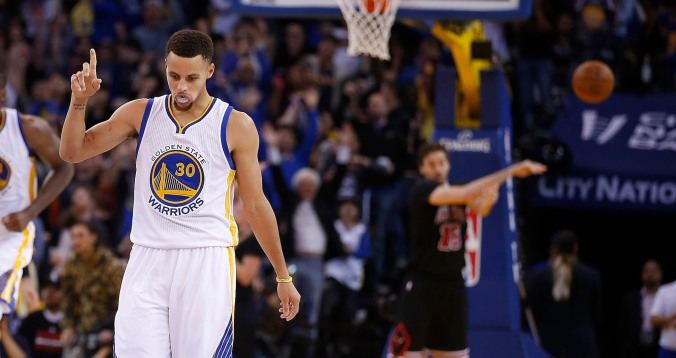 Golden State Warriors' Stephen Curry reacts after making a 3-point shot against the Chicago Bulls during the second half of an NBA basketball game Friday, Nov. 20, 2015, in Oakland, Calif. Warriors won 106-94. (AP Photo/Tony Avelar)